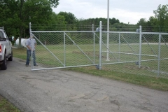 1702_cantelever gate with barbwire
